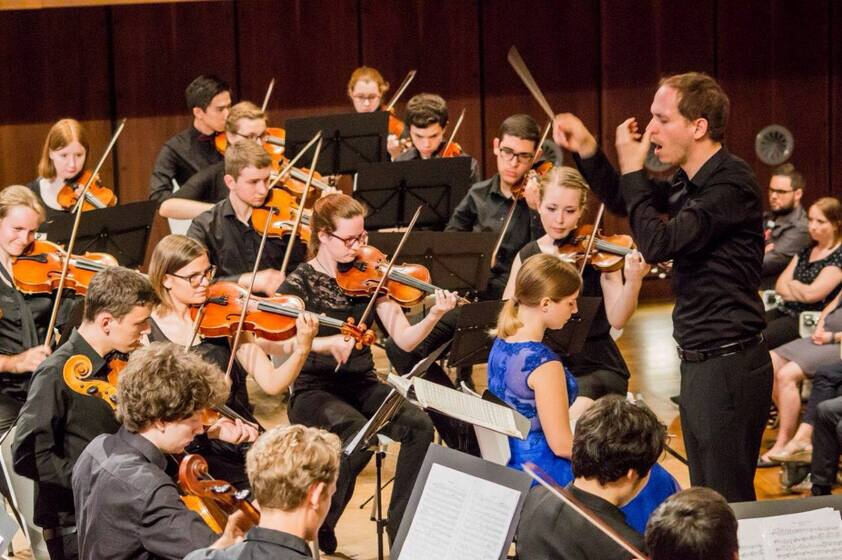 Conductor and orchestra at work